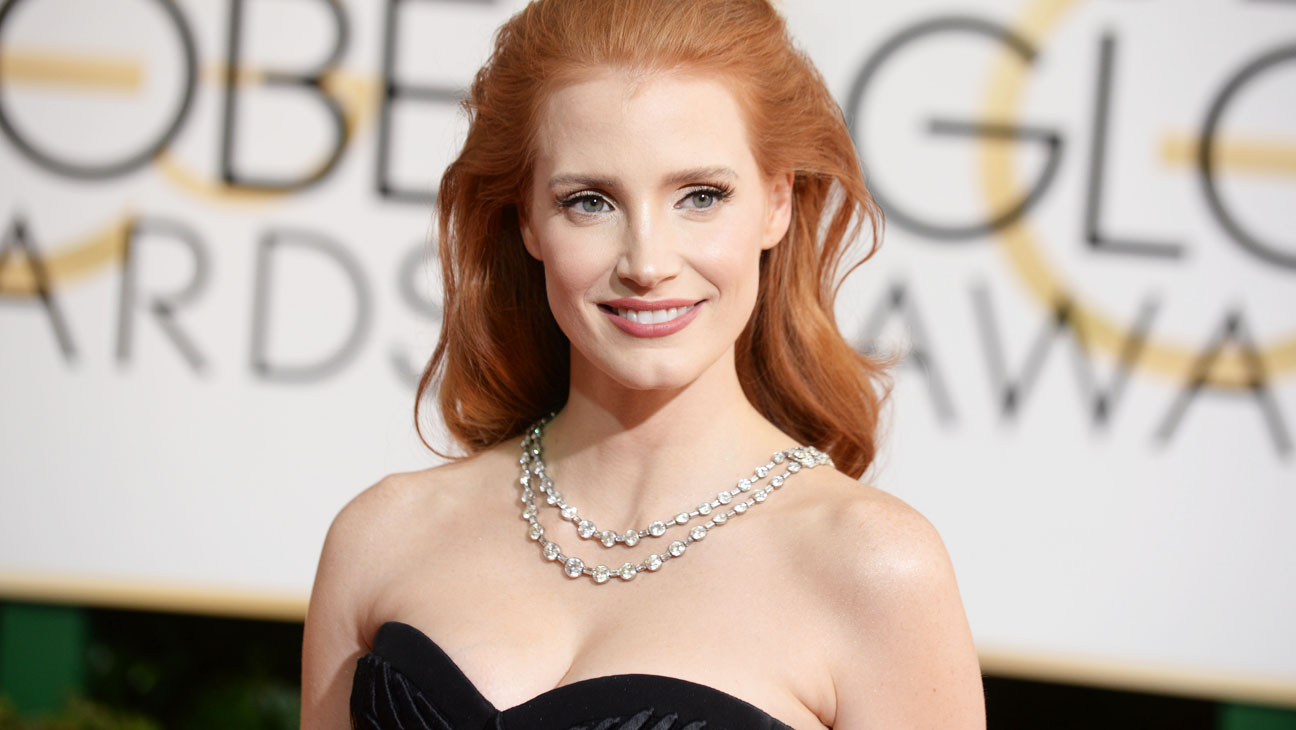 Jessica Chastain arrives at the 71st annual Golden Globe Awards at the Beverly Hilton Hotel on Sunday, Jan. 12, 2014, in Beverly Hills, Calif. (Photo by Jordan Strauss/Invision/AP)