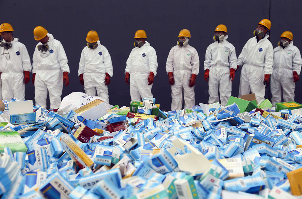 This picture taken on March 14 shows health workers preparing to destroy fake medicines seized in Beijing in recent months.  The rapid growth of Internet commerce has led to an explosion of counterfeit drugs sold around the world, with China the biggest source of fake medicines, pharmaceutical experts said as the illicit trade is now believed to be worth around 75 billion USD globally, with criminal gangs increasingly using the web to move their products across borders.     CHINA OUT      AFP PHOTOSTR/AFP/Getty Images ORG XMIT: