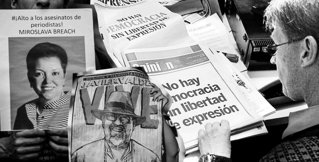A man looks at the front pages of independent newspapers, all reading