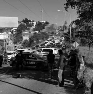 Efecto ESPEJO   En Culiacán, la muerte viaja en automóvil