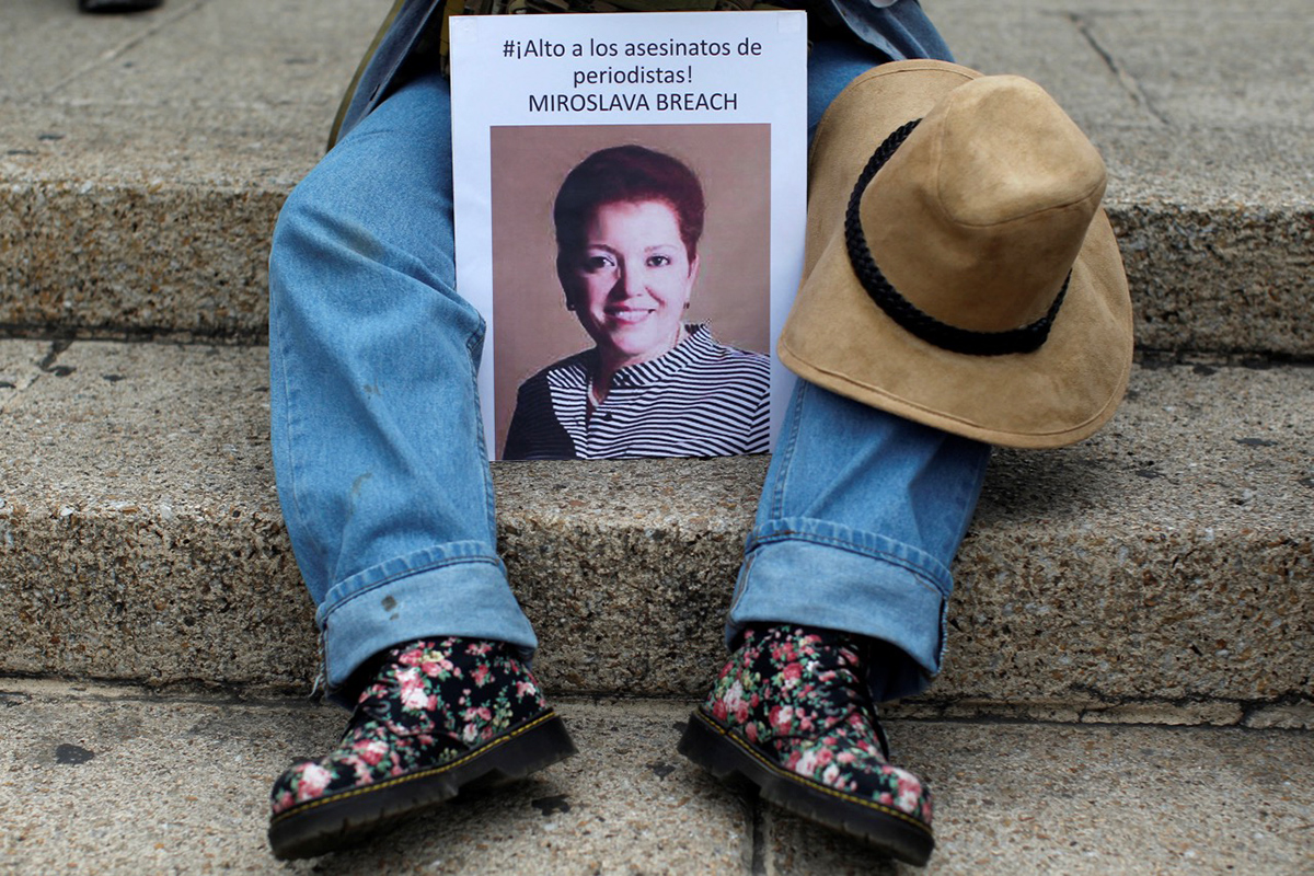 A picture of the Mexican journalist Miroslava Breach is seen during a protest against the murder of Miroslava, in Mexico City, Mexico March 25, 2017. Picture reads